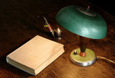 Old lamp, book and pipe — Zdjęcie stockowe