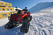 Snow scooter in the mountains — Stockfoto