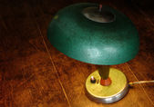 Old green lamp on the old table — Stok fotoğraf