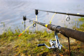 Two fishing rods on the coast of lake — Stock Photo