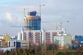 Big building under construction with few cranes — Stock Photo