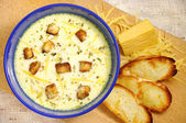 Delicious cheese soup with toasts — Stock Photo