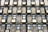Block of flats background with windows and balconies — Stock Photo
