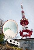 Red transmitter and big antenna — Stock Photo