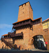 Old gate tower in city walls. It is a part of old fortification in Namyslow — Stock Photo