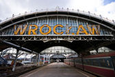 "Worn-out ""wroclaw"" letters on old railway station — Stock Photo"