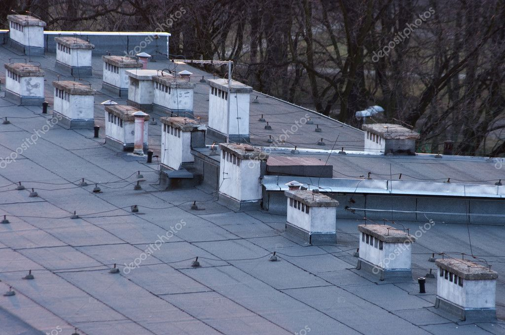 Flat roof with many chimneys — Stock Photo #7919419
