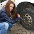 Young woman during the wheel changing — Stock Photo #7929300