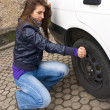 Young woman during the wheel changing — Stock Photo