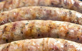 White sausage during the roasting — Stock Photo