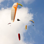 Group of paragliders and blue sky — Stock Photo
