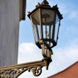 Stock Photo: Old gas lantern on the wall