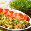 Scrambled egg with tuna and cress — Stock Photo