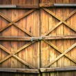 Wooden door with four crosses - Stock Photo