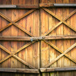 Wooden door with four crosses — Stock Photo