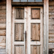 Old door in wooden cottage — Stock Photo
