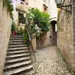 Courtyard with stairs in Mediterranean town — Stock Photo