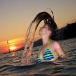 Water splash by hair — Stock Photo