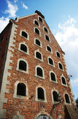 Old brick granary and blue sky — Stock Photo