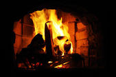 Flames in old brick fireplace — Stock Photo