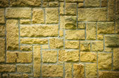 Strange brickwall with green blocks — Stock Photo