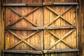 Wooden door with four crosses — Photo