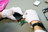 Mobile phone during the reparation by technician — Stock Photo
