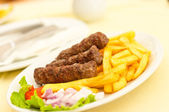 Cevapcici with chips — Stock Photo