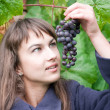 Young woman with grapes - Stock Photo
