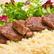 Tenderloin steaks in wine sauce with cadamon and kuskus groats — Stock Photo #7949526