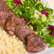 Tenderloin steaks in wine sauce with cadamon and kuskus groats — Stock Photo #7949658
