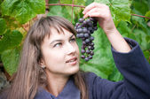 Young woman with grapes — Stock Photo