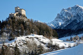 Tarasp Switzerland village in the winter with a castle — Stock Photo