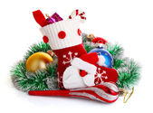 Christmas sock with present and decoration — Stock Photo