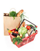 Basket and bag with products — Stock Photo