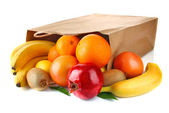 Paper bag with fresh ripe fruit — Stock Photo