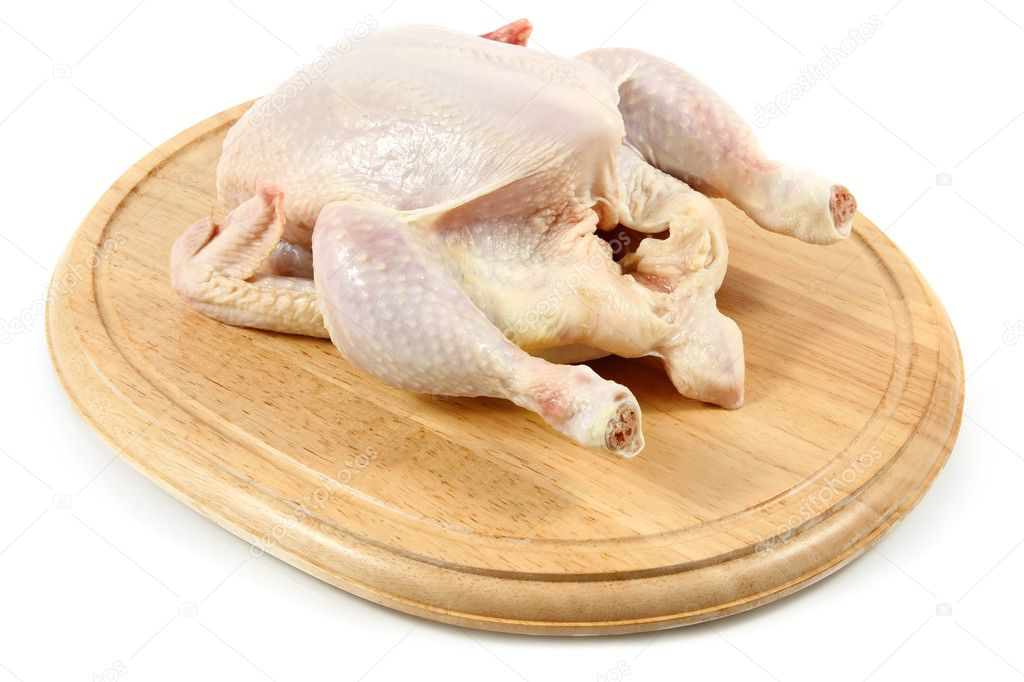 Raw chicken on wooden hardboard isolated white background  Stock Photo #9136706