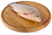 Pescar en el tablero de madera — Foto de Stock