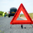 Red warning triangle with a broken down car — Stock Photo #7960116