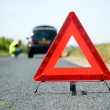 Stock Photo: Red warning triangle with a broken down car