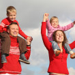 thumbnail of Children on parents shoulders