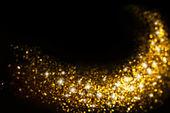 Golden Glitter Trail with Stars Background