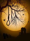 Hangmans noose hanging from a bare tree against a full moon with abbey and grave yard in background