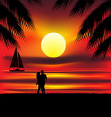 Two lovers on the beach with tropical sunset palms sea and island behind them