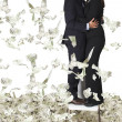 thumbnail of Business couple with lots of money
