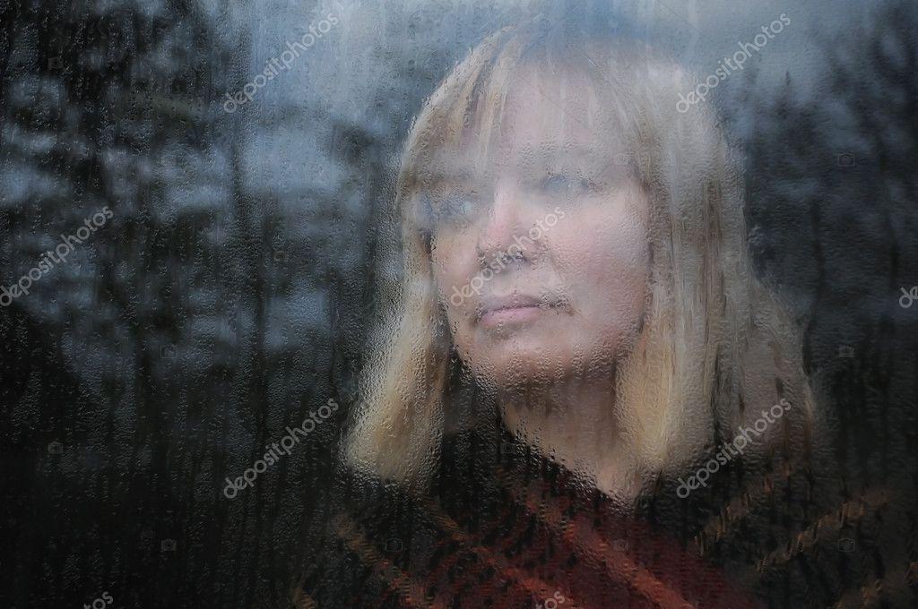 Portrait of Woman Through the Window