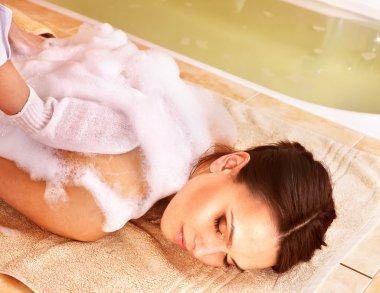 Massage of woman in beauty spa.