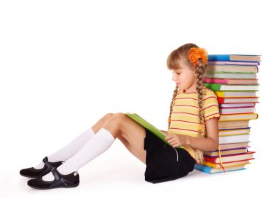 Schoolgirl sitting with pile of books.