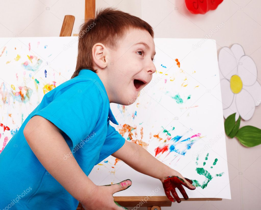 Child with easel draw hands.