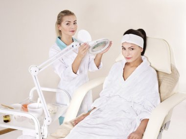 Young woman in beauty spa.
